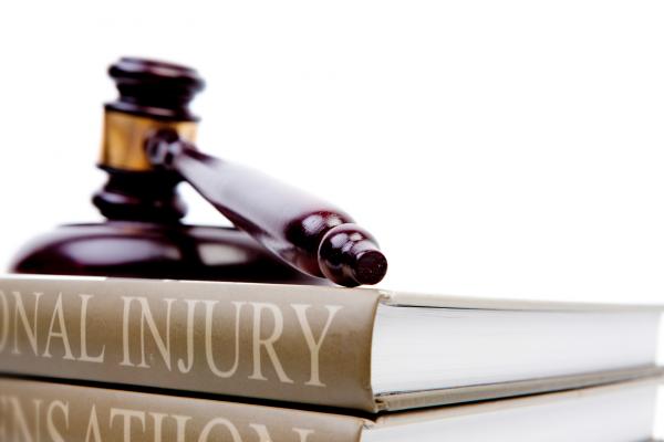 Personal Injury Law Books & Gavel